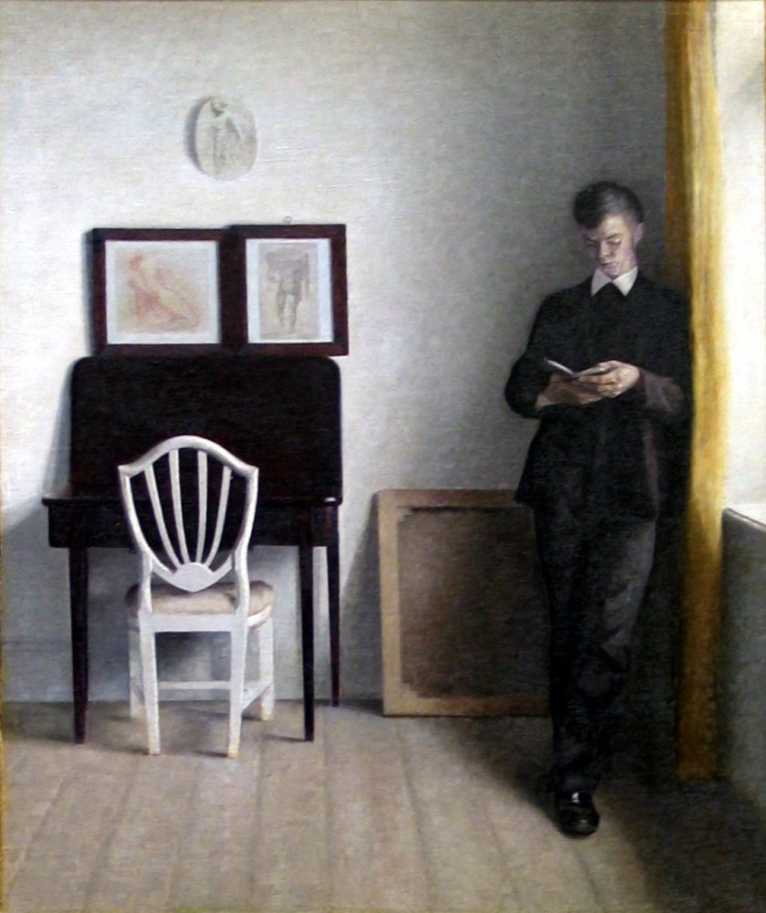 Vilhelm Hammershøi – Interior with young man reading
