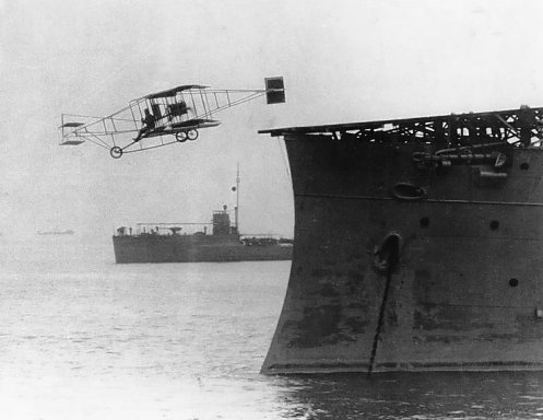 November 14th - Eugene B. Ely demonstrates the feasibility of an aircarft carrier, launching his airplane from the deck of the cruiser USS Birmingham, then flying five miles before landing at Hampton Roads, Virginia