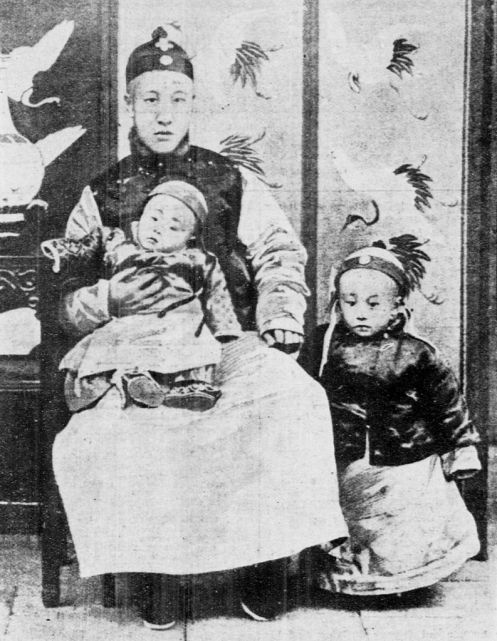 April 3 - Zaifeng, Prince Chun, becomes China's regent for his 2-year old son, Emperor Puyi (standing)