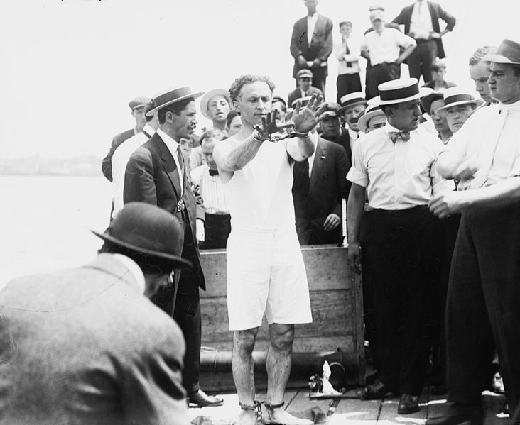 July 7 - Harry Houdini escapes handcuffs, leg irons, and an underwater coffin